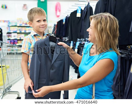 Mom chooses a suit for little son