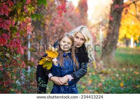 Mom daughter autumn walk family - stock photo