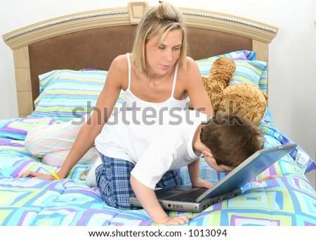 mother son having tickle fight bed stock photo 971914 shutterstock. Black Bedroom Furniture Sets. Home Design Ideas