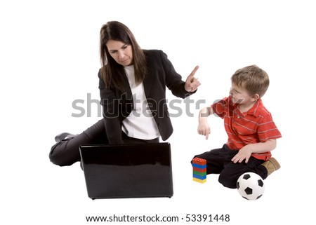 Mom is pointing to her son to wait while she works. - stock photo
