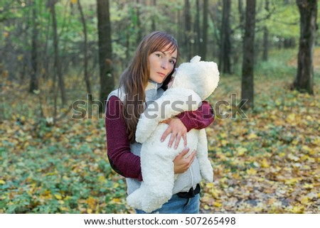 mom lulls baby in the woods