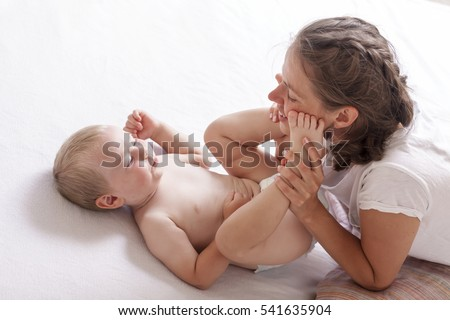 mom play change baby diaper