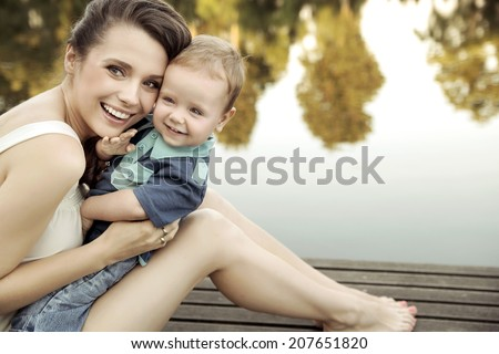 Mom playing with her child - stock photo
