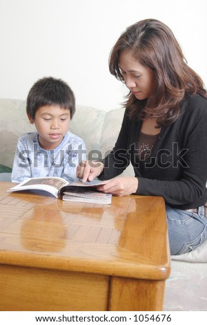 mom reading at home to son