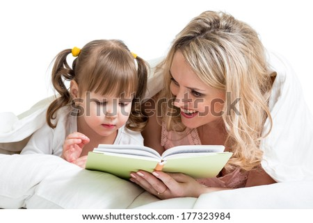 mom reading to kid a book in the bed - stock photo