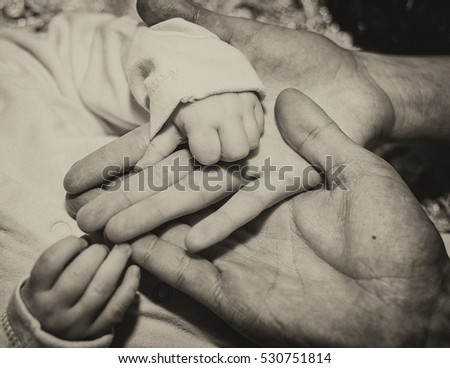 Mom's hand and the hand of child