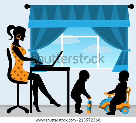 mom sitting at the computer, while the children play in the room  - stock photo