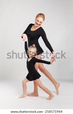 Mom teaching daughter dancing. Mom teaching daughter dancing - stock photo
