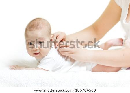 Mom wears a cute baby. - stock photo