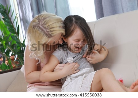 Mom with a child fool around, hugging, laughing. tickling daughter  - stock photo