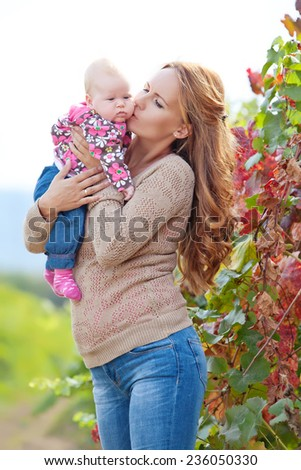 Mom with a young child in nature - stock photo