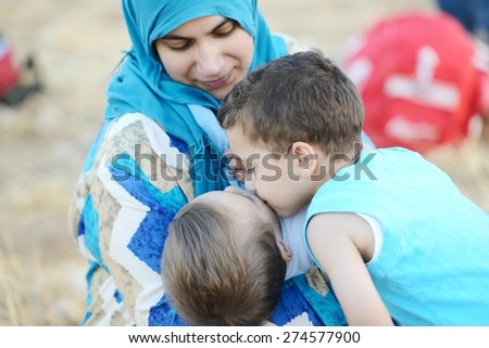 Mom with baby in nature - stock photo