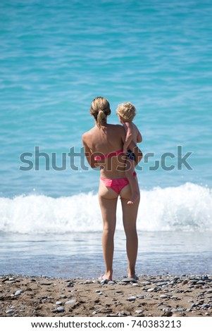 mom with baby on beach landscape