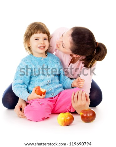 mom with daughter having a healthy way of life, and eat apples isolated on white background