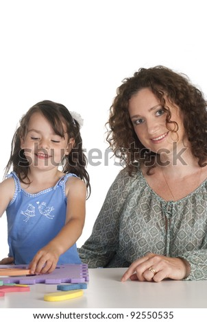 mom with her daughter on a white background - stock photo