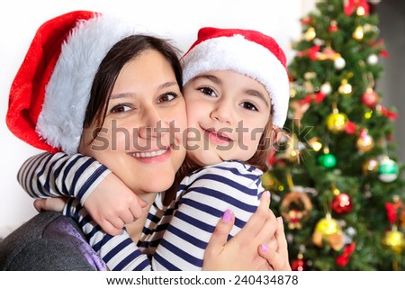 Mom with her daughter on Christmas/Mom with her daughter on Christmas - stock photo