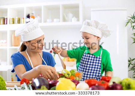 Mom with kid making lettuce at kitchen