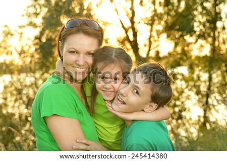 Mom with kids in summer - stock photo