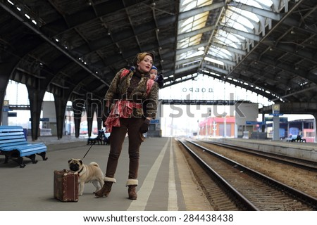 Mom with son and dog travel by train - stock photo