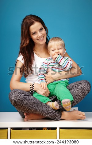 Mom with son on lap - stock photo