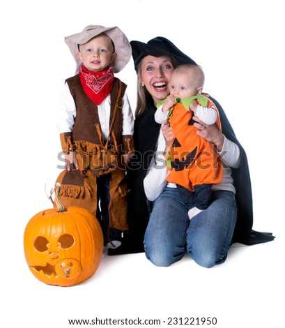 Mom with two kids in costumes - stock photo