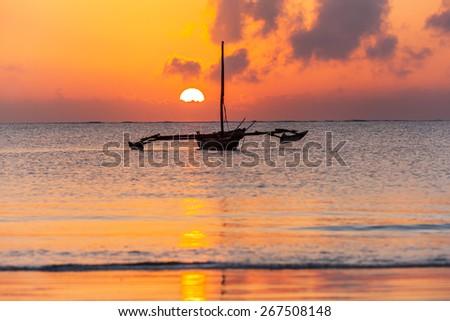 Mombasa, beach, sunrise, africa, sun, boat, kenya ,Sunrise over the Indian Ocean - stock photo