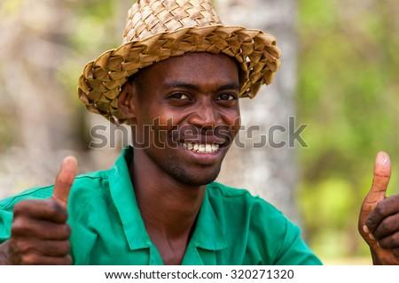 Mombasa, Kenya - 07 January: Man gardener hotel worker on January 7, 2013 in Mombasa, Kenya. - stock photo