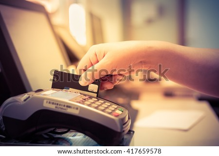 Moment of payment with a credit card through terminal.monochrome - stock photo