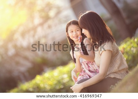 Moment of tenderness, Happy young mother with her daughter at park