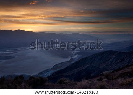 Moments after sunset looking down at Badwater Basin salt flats in Death Valley, CA.  Taken from Dante's View.