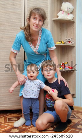 mommy with her two sons at home - stock photo