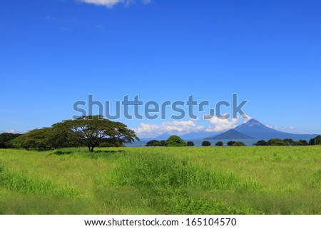 Momotombo volcano view from the shore of Lake Managua - stock photo