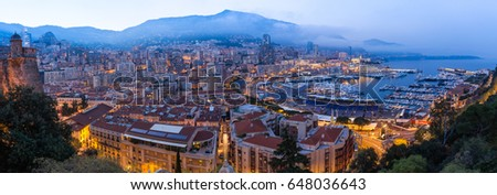 MONACO - APRIL 13, 2015: Panorama shot in the evening of the Monaco Harbour and preparations for the Monaco Grand Prix 2015. The Grand Prix is a Formula One motor race held on Circuit de Monaco