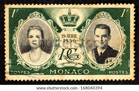 MONACO - CIRCA 1956: Green color stamp printed in Monaco with portrait of Grace Kelly and Prince Rainier to commemorate their marriage, circa 1956. - stock photo