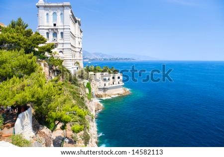 Monaco coast. Ancient buildings and blue sea. - stock photo
