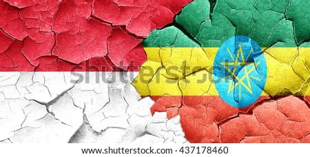 monaco flag with Ethiopia flag on a grunge cracked wall - stock photo