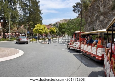 MONACO, JUNE 26, 2014: Tourist train goes towards the princely palace. The route begins at the Oceanographic Museum - stock photo