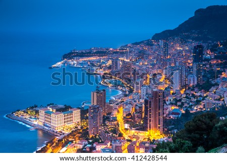 Monaco, Monte-Carlo, 05 april 2016: Timelapse shoot of Monte-Carlo aerial view, night lights, night city, port Hercule, Prince Palace of Monaco, mountain, skyscrapers, zoom effect, mediterranean sea