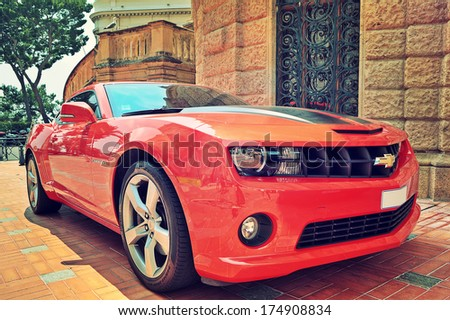 MONACO-VILLE, MONACO - JULY 13, 2013: Red Chevrolet Camaro - fifth generation of Camaro high performance automobiles (muscle car) produced by General Motors since its original introduction in 1967. - stock photo