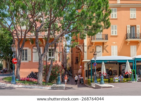 MONACO-VILLE, MONACO - JULY 13, 2013: Small restaurant and traditional colorful houses in Monaco-Ville - old town and one of the four quarters of Monaco with Prince's palace as main tourist landmark. - stock photo