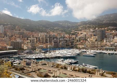Monaco yacht harbor end mountains around town - stock photo