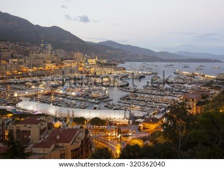 Monaco Yacht Show. Port at dusk. - stock photo