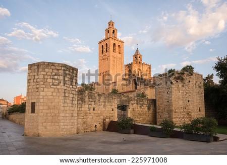 Monastery in town center, morning golden hour, Sant Cugat del Valles, Catalonia, Spain - stock photo