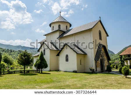 Monastery on the river Moraca mountains in the background Montenegro