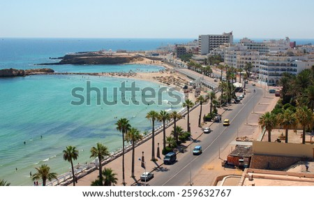 MONASTIR, TUNISIA - August 01, 2012: People swimming in the Mediterranean Sea at the beach