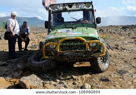 "MONCHEGORSK, RUSSIA - JULY 15: Unidentified racer at off-road car leaves steep slope in the ""OFF-ROAD SHOW 2012"" on July 15, 2012 in Monchegorsk (Murmansk region), Russia - stock photo"