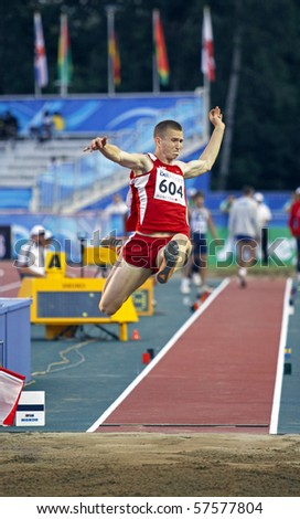 MONCTON, CANADA - JULY 20: Nikita Pankins of Latvia (LAT) performs the long jump during the 2010 IAAF World Junior Championships on July 20, 2010 in Moncton, Canada.