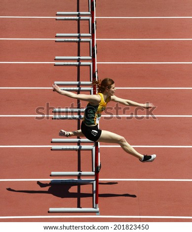 MONCTON, CANADA - June 28: Adrea Propp competes in the women's 400-metre hurdles at the Canadian Track & Field Championships June 28, 2014 in Moncton, Canada. - stock photo