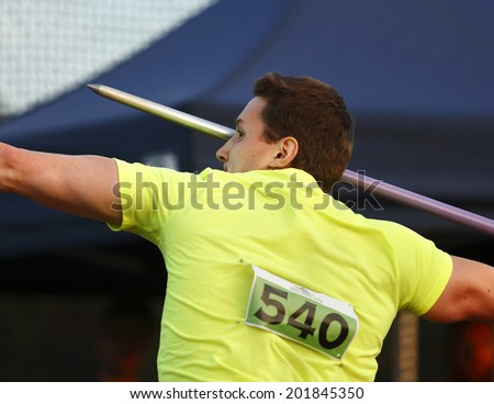 MONCTON, CANADA - June 28: Caleb Jones aims the javelin at the Canadian Track & Field Championships June 28, 2014 in Moncton, Canada. - stock photo