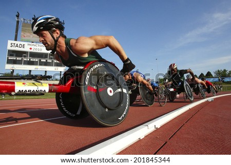 MONCTON, CANADA - June 28: Jean-Philippe Maranda leads the pack in the men's 1500-metre wheelchair at the Canadian Track & Field Championships June 28, 2014 in Moncton, Canada. - stock photo